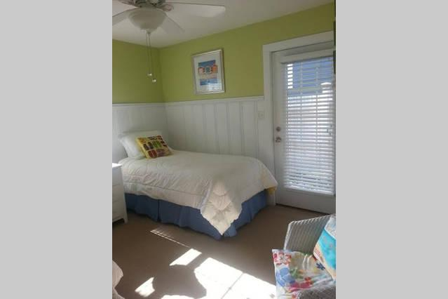 2nd bedroom has 2 twin beds and 1 single day bed. French door opens to back courtyard.