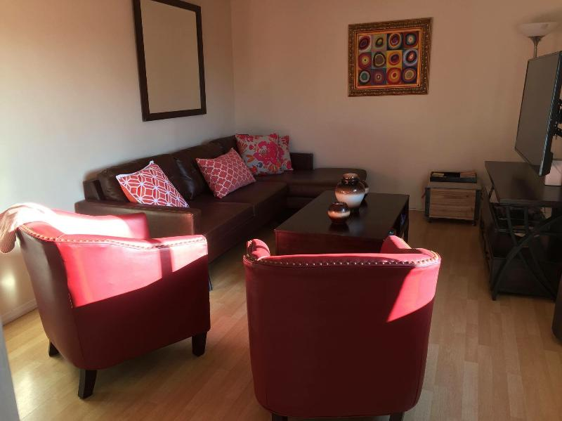 Living Room with comfortable sectional and large Flat TV