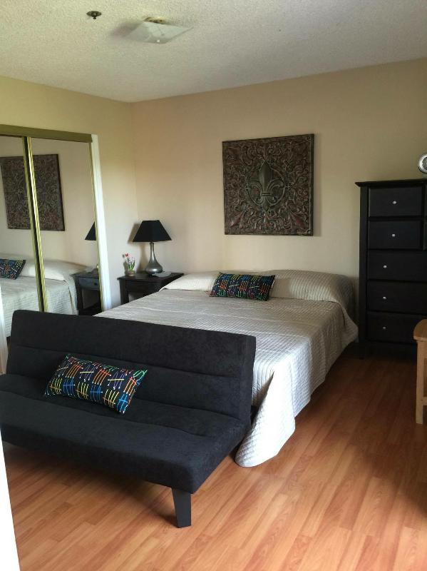 Master bedroom with Cal King bed and Folding futon for a small person or a child