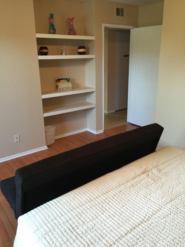 Master bedroom with Cal King bed and futon for child or small person