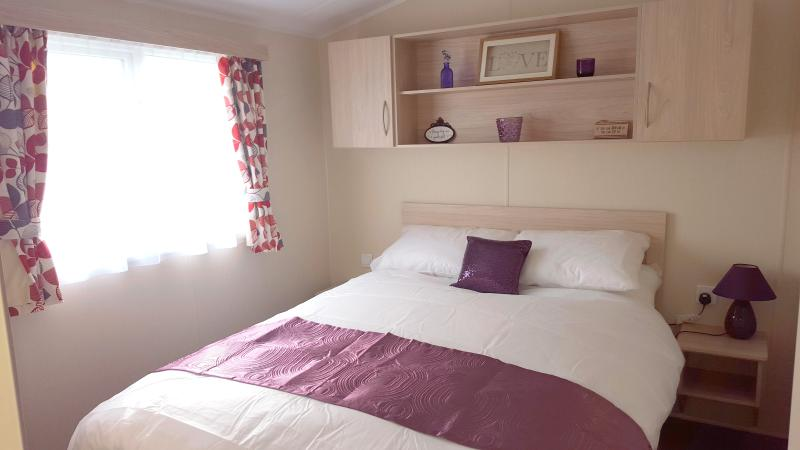 Master bedroom with ensuite, hairdryer, wardrobe and hangers