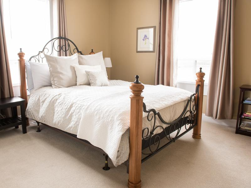 Master bedroom has a queen size bed and ensuite with walk-in shower and deep soaker tub.