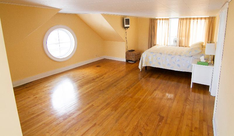 This Master Bedroom is 1 of 3bdrms  on 3rd Storey  w/ King Sized Bed - Connected to bunk bed bedroom