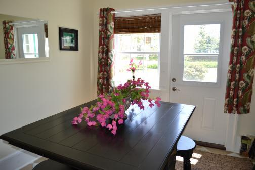Second Dining area with bistro table, access off to side yard with BBQ and outdoor seating
