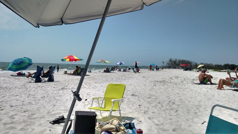 units includes beach chairs, umbrella and cooler
