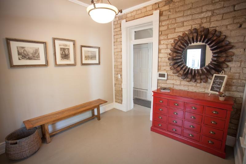 Entryway, Original adobe brick walls.