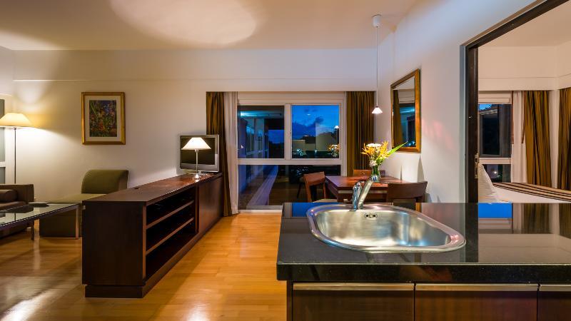 RCG Suites - um quarto