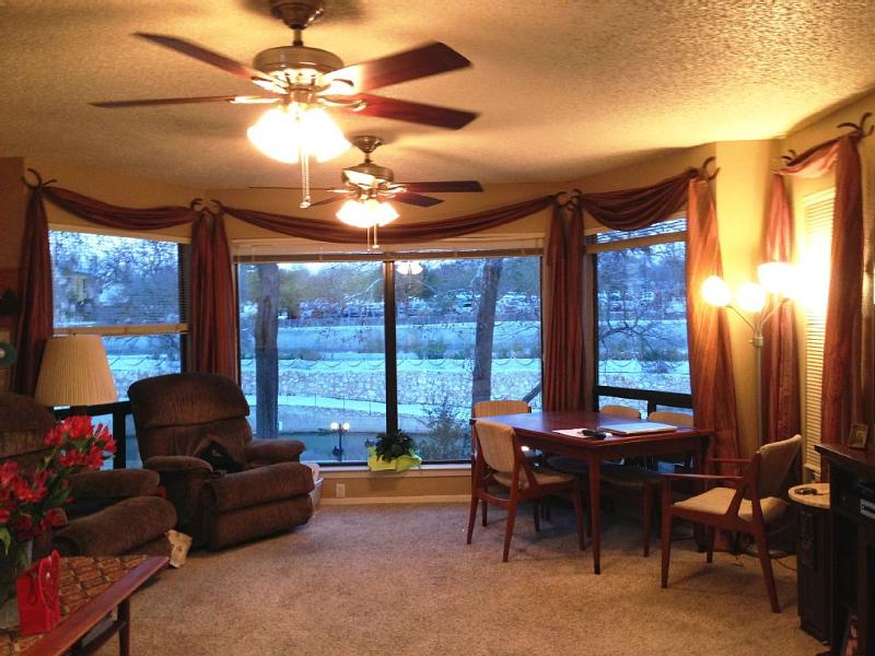 living room with view of Schlitterbahn across the Spring fed Comal river