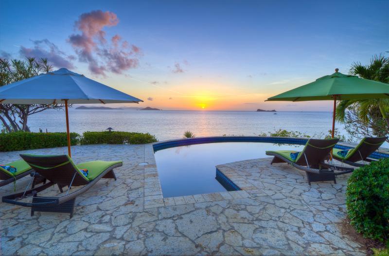 Watch the sunset between islands on the horizon