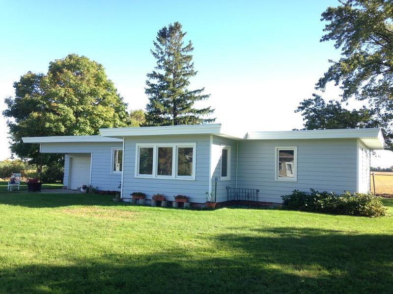 Mid-century Ranch across lane available separately. Contact Dawn