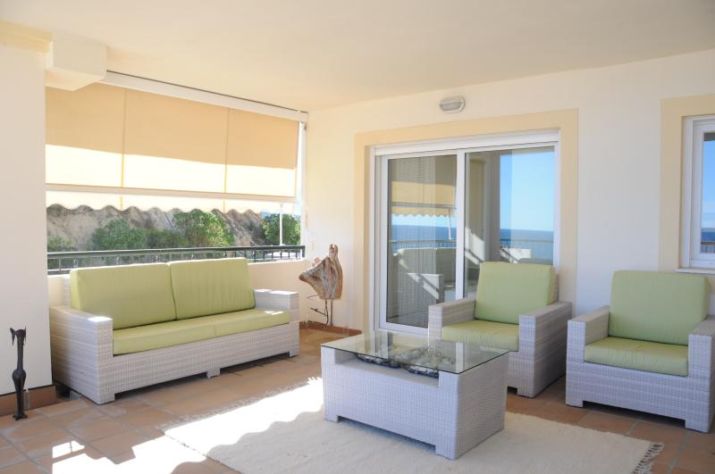 The spacious terrace with relaxing furniture again with the sea views.