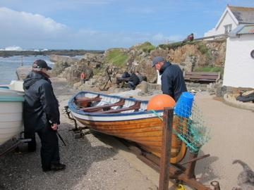 Dunseverick Harbour and a 100 year old fishing boat, near Ballintoy