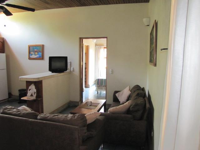 # 10 living area with sofas.  Bedroom in background.  This unit has two air conditioners.