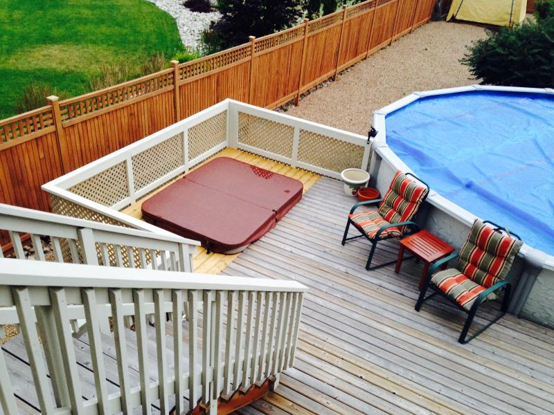 A view of the hot tub and heated pool from the main floor of our home.