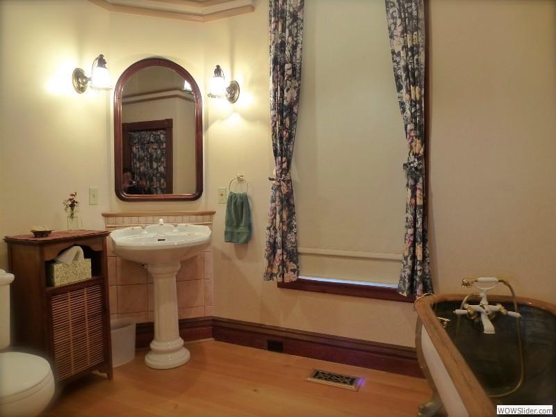 4 piece bathroom, Toilet, sink, large shower and antique soaker tub.