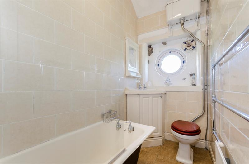 BATHROOM WITH SHOWER -  JACK N JILL TO FRONT AND BACK BEDROOM
