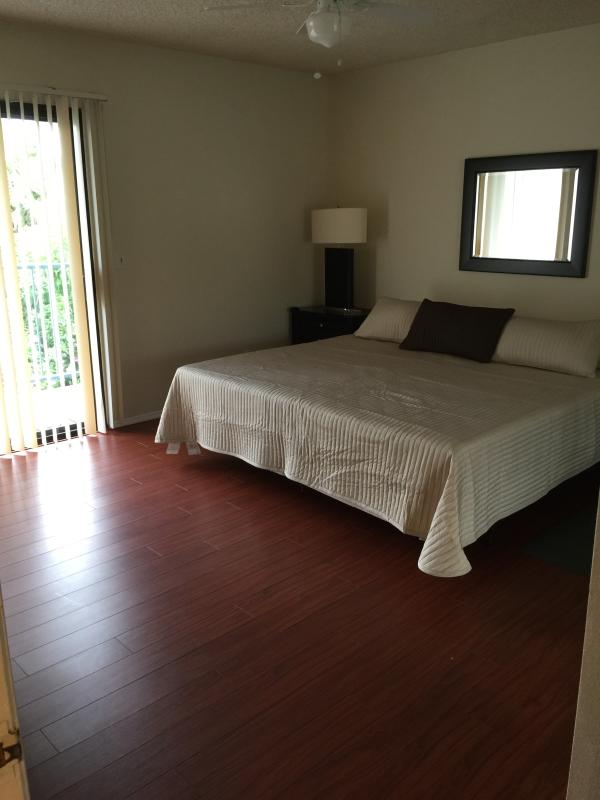 Master bedroom with Cal King bed and Private balcony