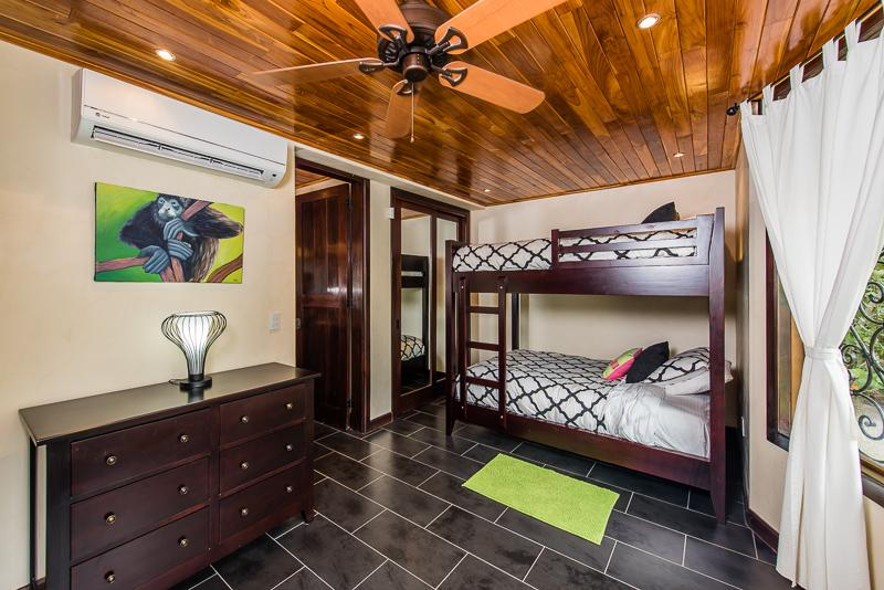 Bunk room with 4 full beds and shared en suite bath