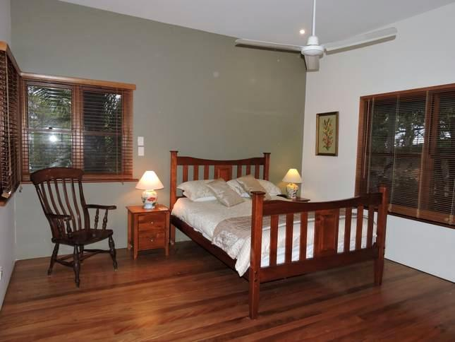 Main bedroom - queen size bed, ensuite, walk-in robe, ceiling fan, TV, french doors, insect screens