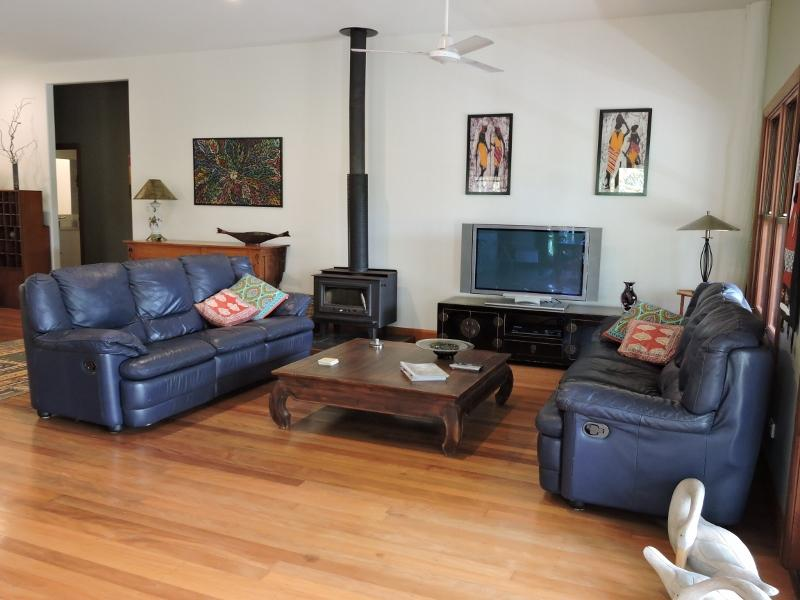 Spacious lounge area - leather lounges, wood combustion heater and gas heater