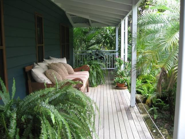 Front deck with Balinese day bed amongst tropical garden