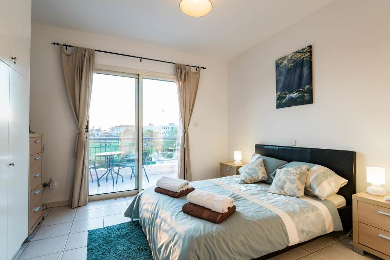 The Master Bedroom with balcony overlooking the pool, air conditioning, ensuite and TV.