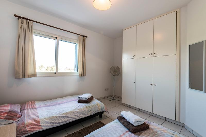 The Twin Bedroom with fitted wardrobes, air conditioning, ensuite bathroom and countryside views.