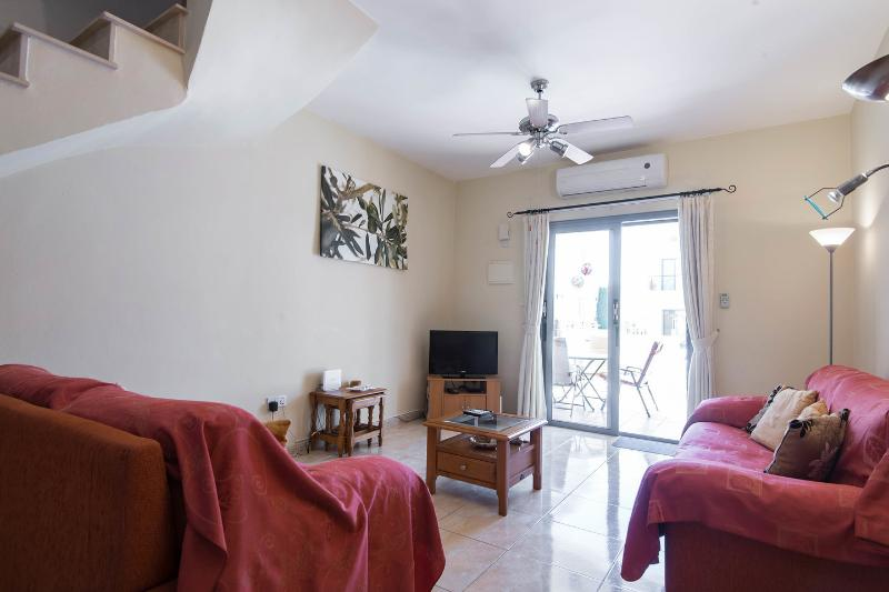 Living Room:  high ceilings and fully air-conditioned