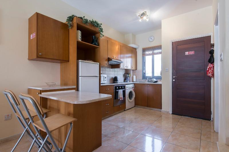 Kitchen: The feature breakfast bar leads to fully functional kitchen and guest cloakroom