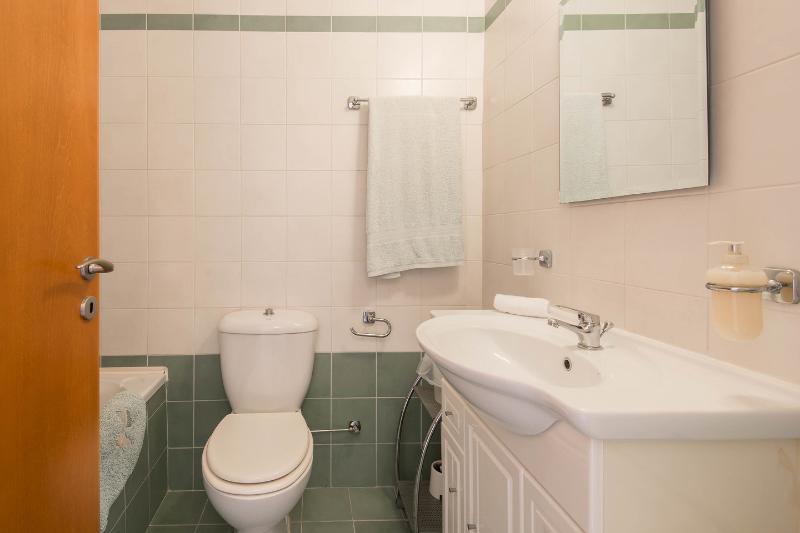 Bathroom: •Family bathroom with shower over bath.