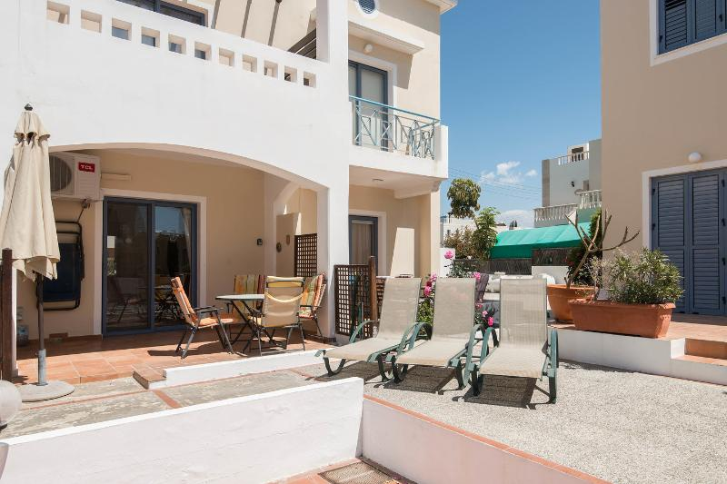 Terrace: Fully covered private terrace overlooking large communal pool