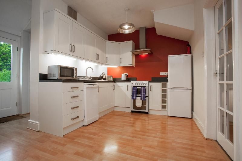 Kitchen - including: electric hob & oven, microwave, dishwasher, fridge/freezer and washing machine.