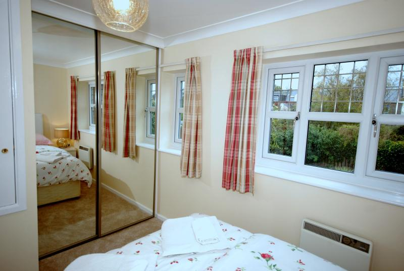 The master bedroom has a double bed and fitted wardrobe.