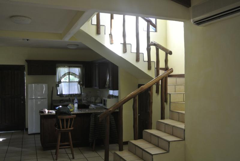 Kitchen area and steps leading to upstairs master bedroom and bathroom
