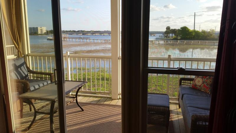 Beautiful view from screened-in porch off family room.