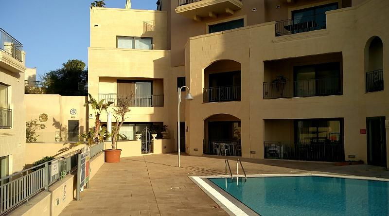 Pool terrace. Apt is groundfloor in the centre of the picture.