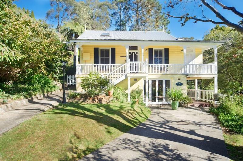 Beautiful 1800's historic country home on 1 acre of lush grounds and gardens with a natural spring