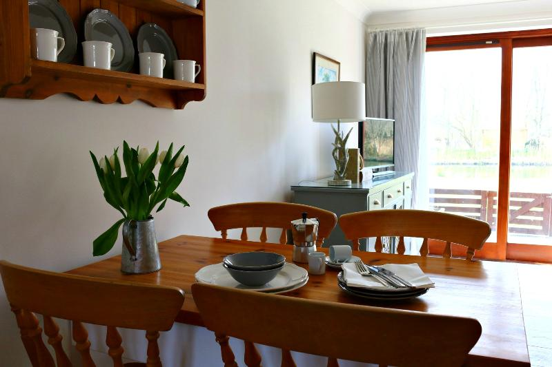 The dining table is perfectly positioned to enjoy views of the lake and the wildlife