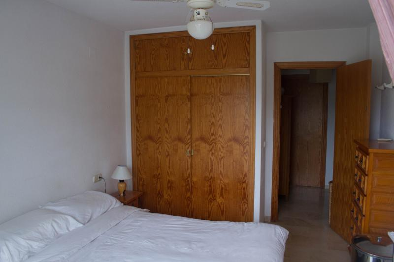 Main bedroom with ceiling fan and air conditioning