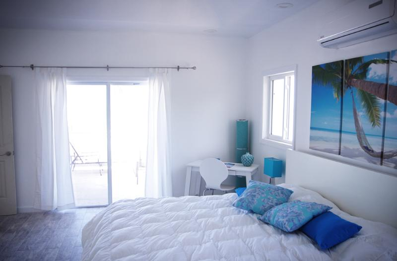 master bedroom with direct access to private beach