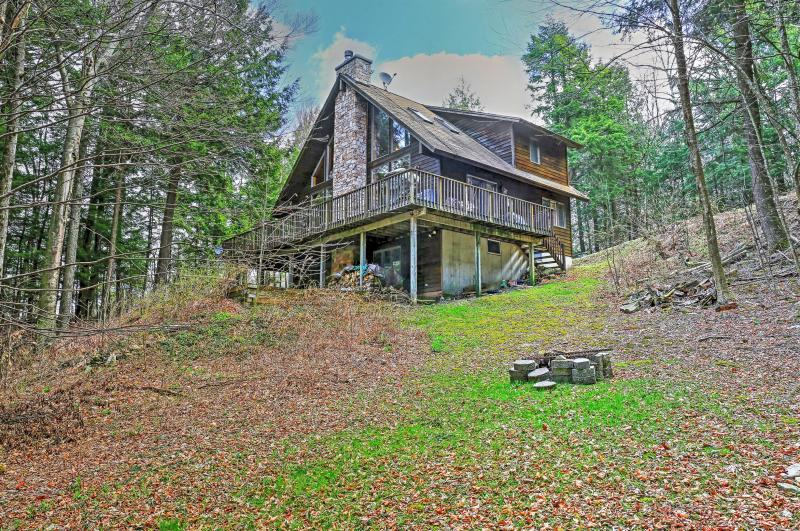 Have an incredible wilderness retreat by reserving this striking lakefront Stamford vacation rental home!