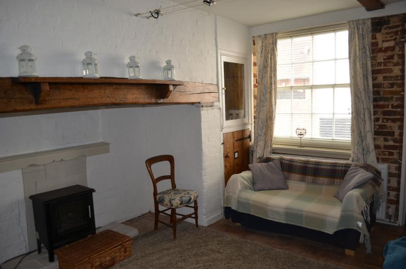 lovely separate lounge, with inglenook fireplace. sofa bed, leather comfy sofa and table and chairs