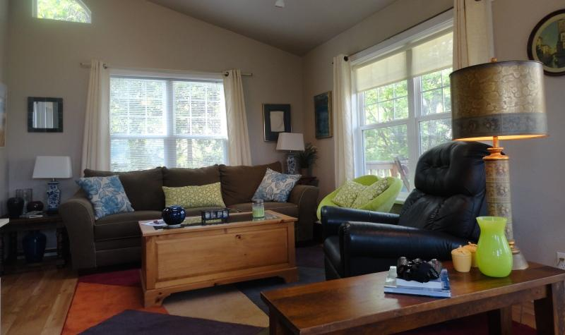Living area with recliner, comfortable couch and entertainment center