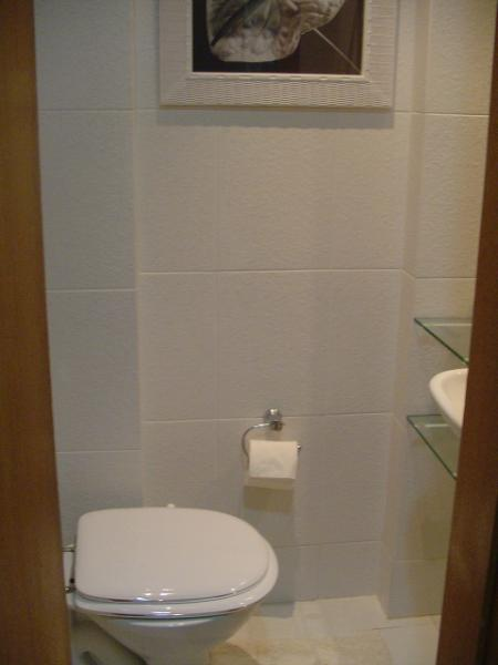 Lavabo with sink, WC, all wall mirror and shelves.
