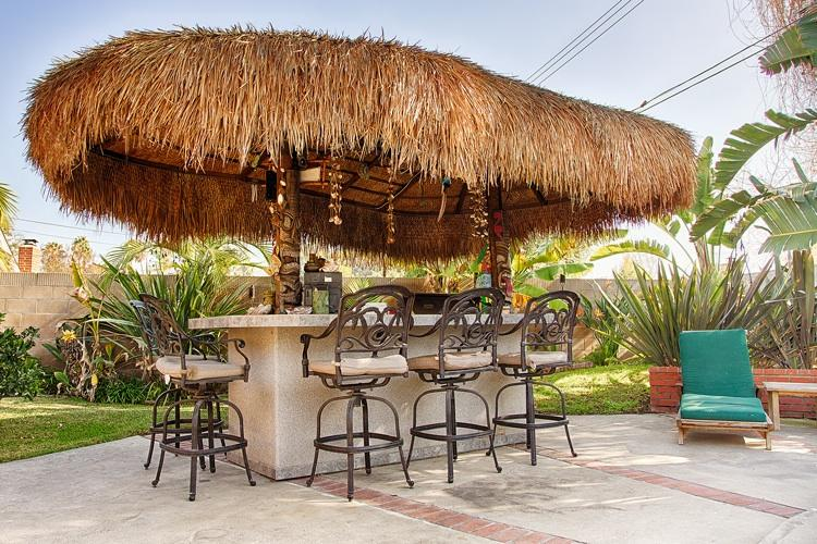 Outdoor island with seating.  Visit the chef while he BBQs.There are 4 teak lounge chairs to get sun