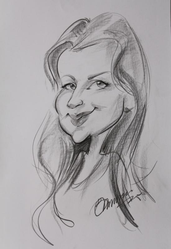 me ;-) During high season you will find many portrait artists along the marina