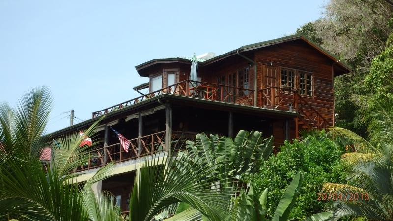 Beautiful villa made of South American Greenheart wood.  Lush gardens with fruits and vegetables!
