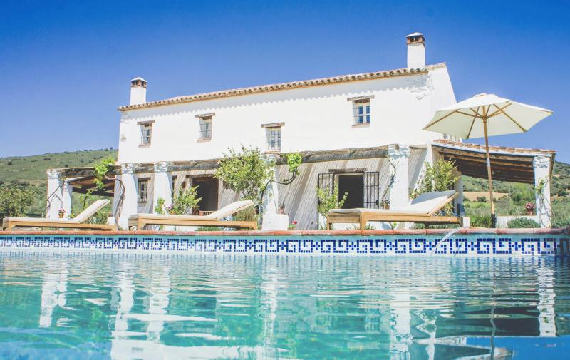 The house sits in rolling countryside surrounded by olives with amazing views towards Ronda.