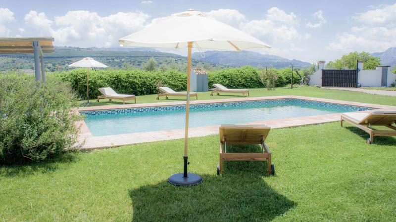 Relax in the enclosed garden by the large private pool with views of mountains and hills all around.