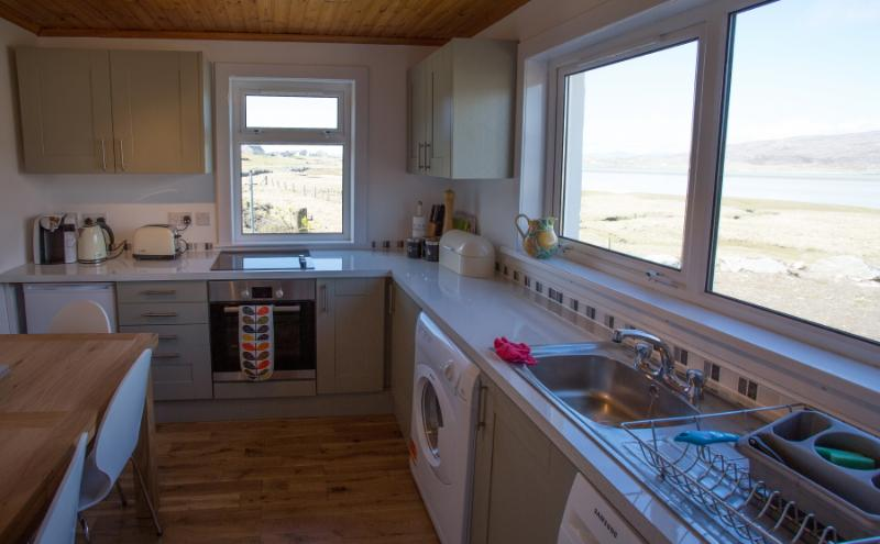 From the kitchen, you can look across Luskentyre Bay to the island of Taransay